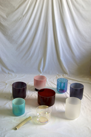 singing bowls: A collection of colorful crystal singing bowls against white backdrop. Stock Photo