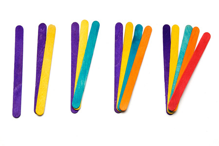 adds: Various colored craft sticks are in groups each color adds another number over white.