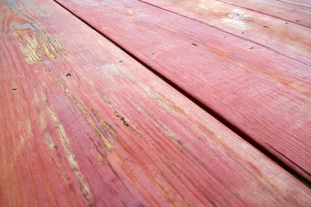 Looking down the length of a red stained wooden picnic table in perspective. Stok Fotoğraf - 30988832