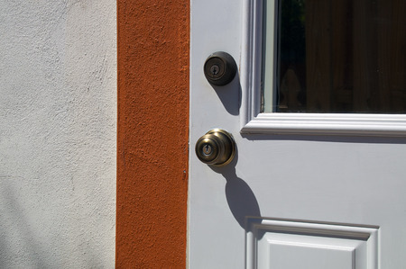 deadbolt: Detail of door with door knob and deadbolt on typical florida home. Stock Photo