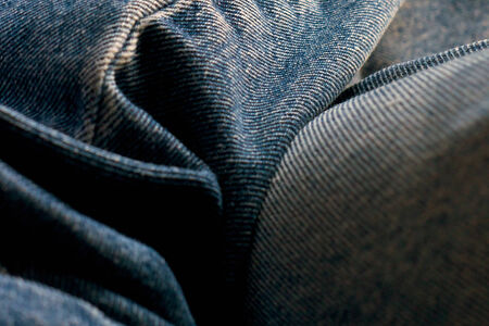 Close up of blue jean dungarees showing wrinkles and folds. Banco de Imagens