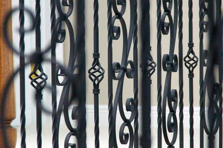 Close up of interior railing made of wrought iron.