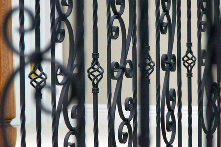 home accents: Close up of interior railing made of wrought iron.