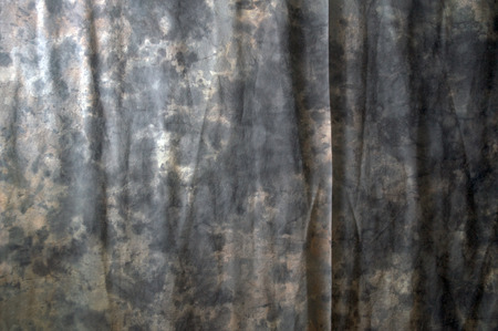 draped cloth: A marbled photographic backdrop fills the entire image with wrinkles and a fine crease.