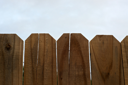 stockade: Looking up over the top of a wooden stockade fence towards the sky. Stock Photo