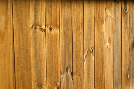 stockade: Looking at an old wooden stockade fence at a slight angle. Stock Photo