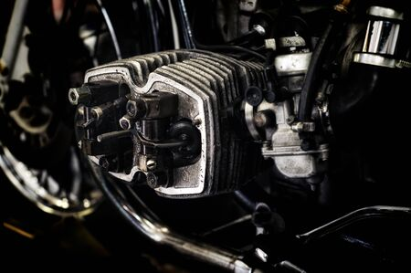 carburetor: Dark gritty image of  russian motorcycle engine with head removed showing valves.