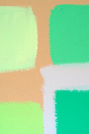 Swatches of different shades of green paint applied to wall to help determine best color for wall.