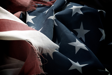 faded: Close up of old United States of America flag that is old, worn and faded. Stock Photo