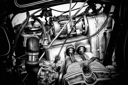 gritty: Gritty and grainy black and white image of the engine of a vintage boxer style motorcycle. Stock Photo