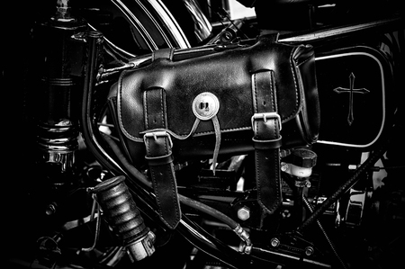 tool bag: Close up of vintage leather tool bag on old motorcycle in black and white.