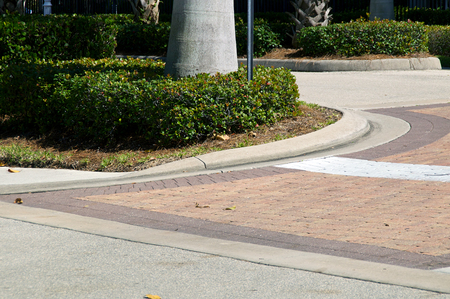 pavers: Entrance to curved driveway made of brick pavers in south west florida.