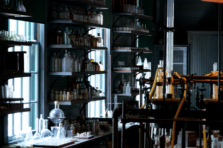 An old abandoned laboratory from the early 1900s. with work tables, bottles, beakers.