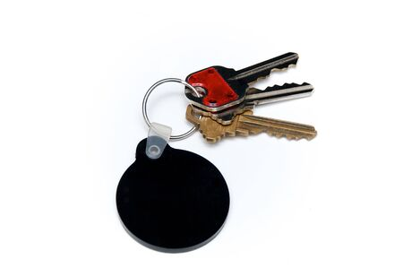 fob: Keyring with assorted keys with blank, round black fob for text. Stock Photo