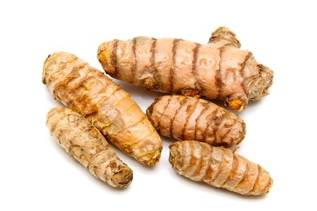 flavorings: A bunch of  fresh Turmeric rhizomes from above, over white, not isolated.
