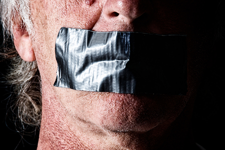 correctness: Highly detailed creepy image of man with mouth duct taped closed. Political correctness or freedom of speech concept. Stock Photo