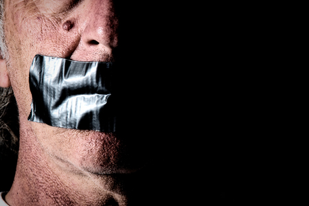 political prisoner: an older mans mouth is covered and taped closed with duct tape, side lit with half of face in shadow, and highly detailed.