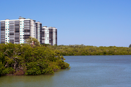 gulf of mexico: Looking out over a river towards modern apartment condo buildings on the horizon on the gulf of mexico coast of florida.