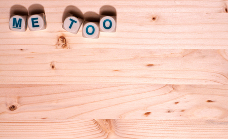 Blank light colored wood fills this template image with the word Me Too spelled out in blocks along the top.