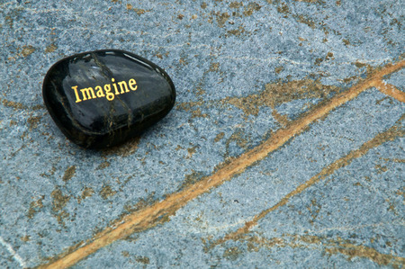 A black polished stone with the word