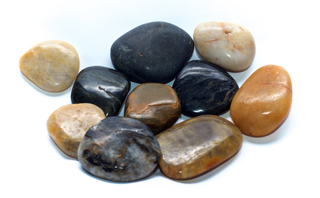 A group of ten large polished stones over white, with room for text. Not isolated.