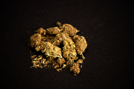 pile of medicinal marijuana on black background. Used as a recreational drug and also alternative medicine.