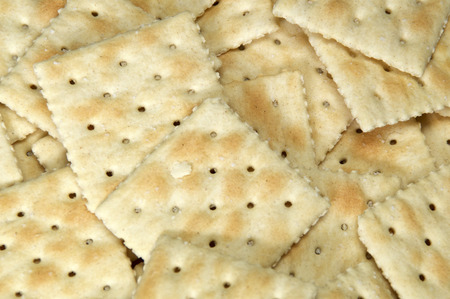 Close up of saltine crackers filling image, also known as soda and soup crackers. Foto de archivo