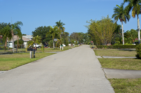 View of empty sururban side street in Bonita Shores, Florida on a sunny morning.