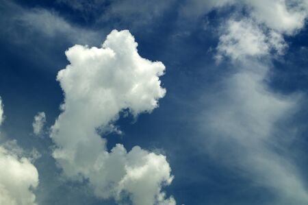 Beautiful thick and puffy clouds fill a deep blue sky in southwest florida at noontime in summer. Фото со стока