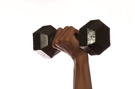 Close up of woman weightlifters hand and wrist lifting metal weight straight up against white. Banco de Imagens