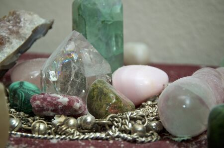 Close up of dusty pagan altar with silver chain and dust covered stones and quartz crystals. Banco de Imagens