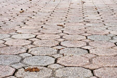 Background low angle image of octagon and square or diamond shaped paver bricks of sidewalk or driveway.