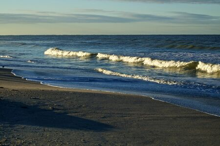 Large cresting waves on bonita beach at the gulf of mexico in bonita springs florida at sunrise. 스톡 콘텐츠