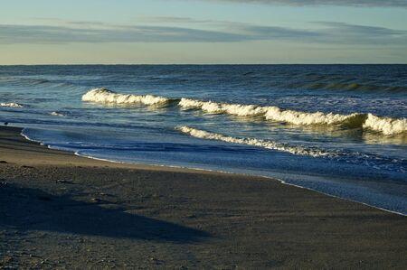 Large cresting waves on bonita beach at the gulf of mexico in bonita springs florida at sunrise. Foto de archivo