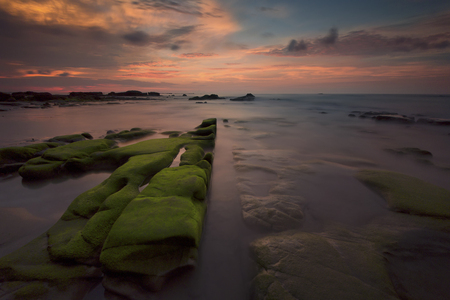 mosses: Beautiful sunset decorated with waves and mosses stone