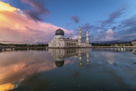 likas: Beautiful twilight view City mosque in Kota Kinabalu, Sabah Borneo. Long exposure photograph with grain. Image contain certain grain or noise and soft focus.