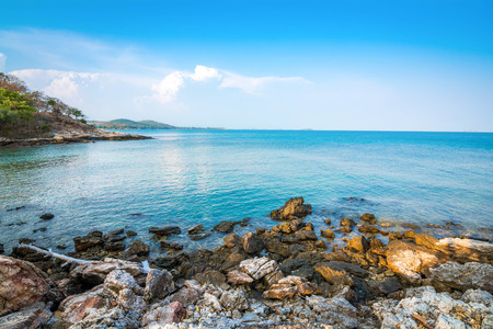 Clear water and Stone shores Beach With Coral Reef on Samet Island, Rayong, Thailand.