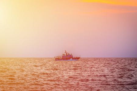 Sailing through sunlight the sea in evening. 写真素材