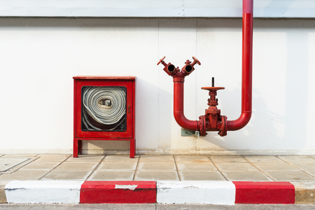Water valve fire and fire hose old with Fire hose cabinet red color, Wall mounted. Archivio Fotografico