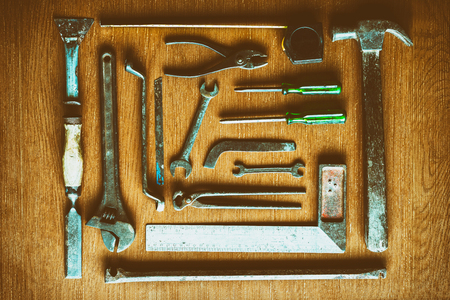 Old Tools set Placed on the wooden floor top view, Vintage Color tone. Stock Photo