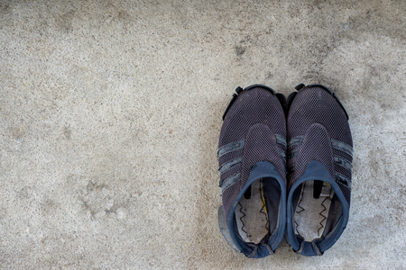 Old Shoes on the concrete floor.