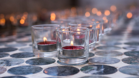 Candle in a glass on floor. Banco de Imagens