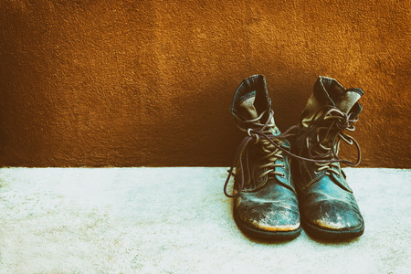 Old Military boots placed on the floor, Vintage color tone.
