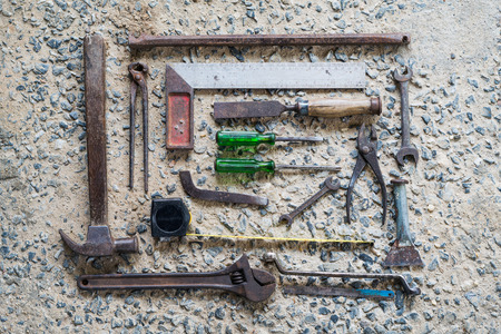 Old Tools set Placed on the cement floor.