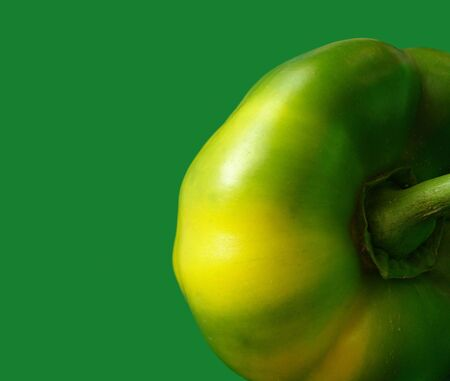 green pepper on a green background Stock Photo