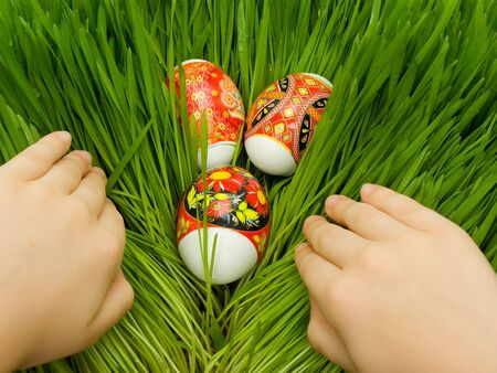Easter eggs decorated Ukrainian folk figure in the grass