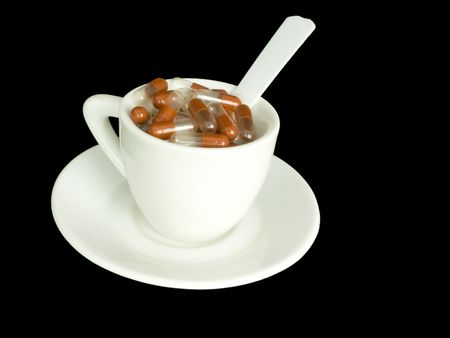 Medical preparations, capsules in a white cup photo