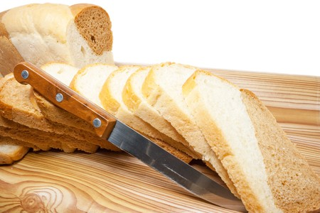 Soft, cut on a table bread, on a white background