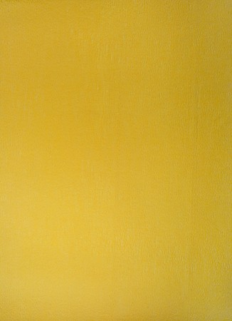 Crushed coloured paper, background of mustard color