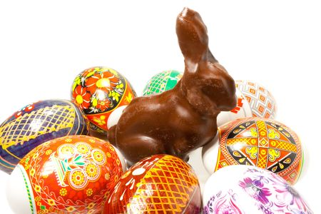 Chocolate easter rabbit in surroundings easter eggs Stock Photo